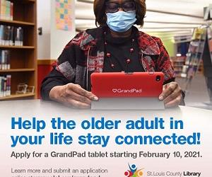 woman sitting looking at a GrandPad tablet